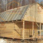 сруб бани 6 на 6 метров с верандой и ломанной крышей