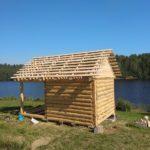 Сруб бани 3 на 3 метра с верандой на берегу озера